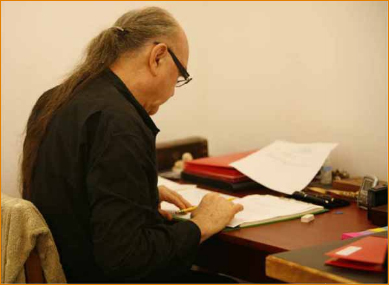 Avatar Adi Da Samraj at work writing in Picture Perfect Art Studio, 2006