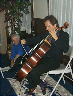 musician Byron Duckwall playing the cello<br>at a recent public event