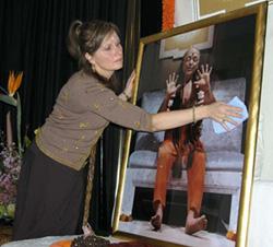 devotee doing a puja on a Murti of Adi Da